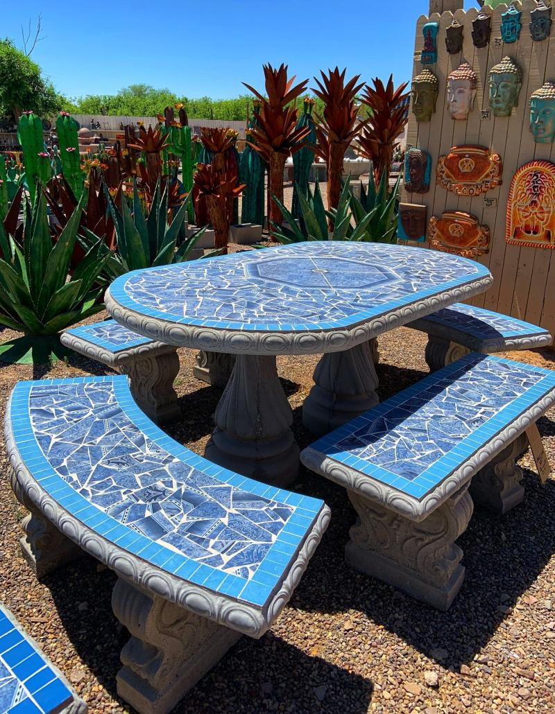 large blue oval tiled table with benches