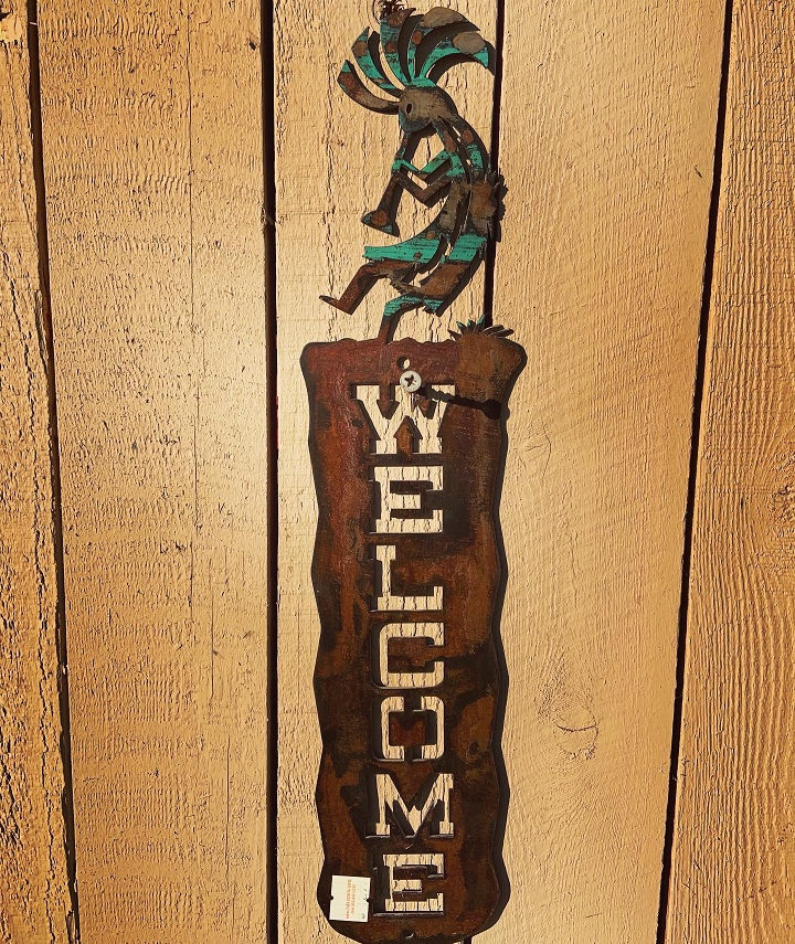 handmade kokopelli steel welcome sign