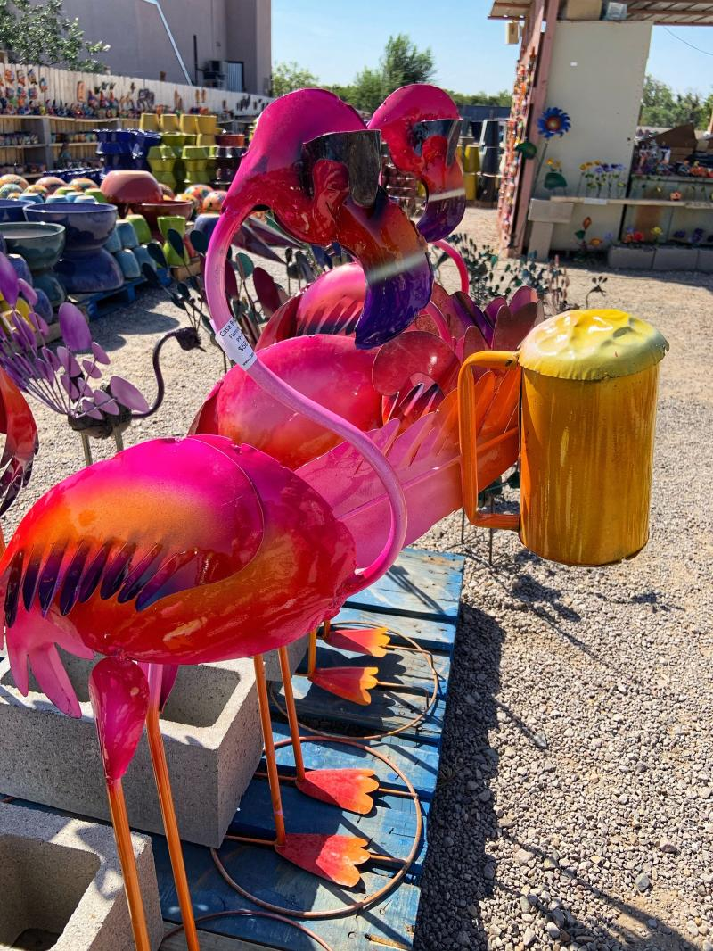 handcrafted pink flamingos holding beer