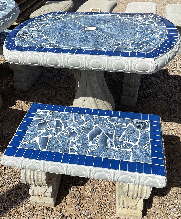 small blue oval garden tile table with benches