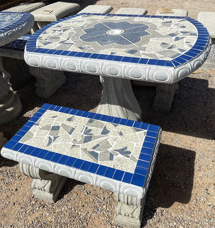 small  grey and blue oval garden tile table with benches