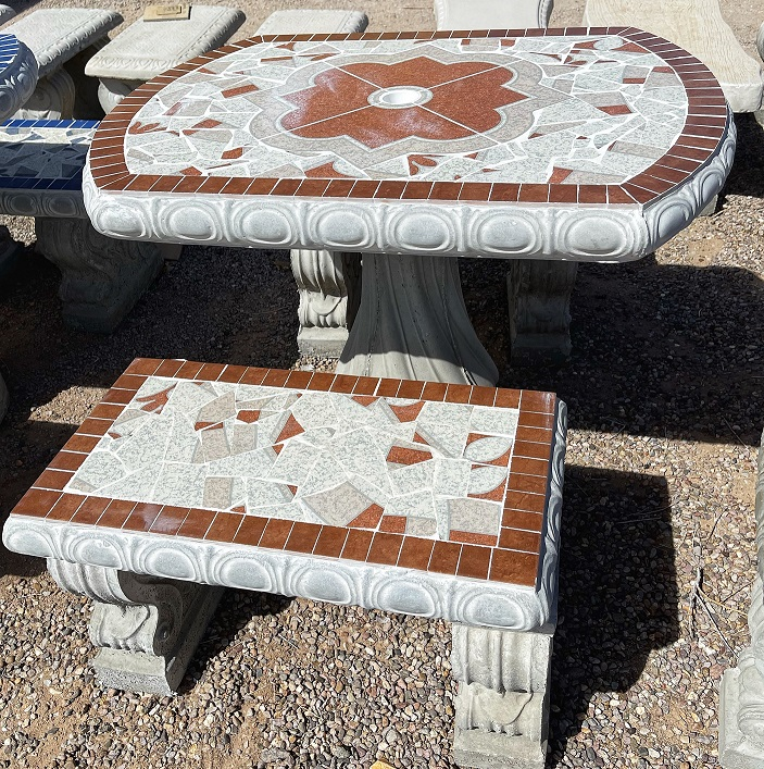 small white and brown oval garden tile table with benches