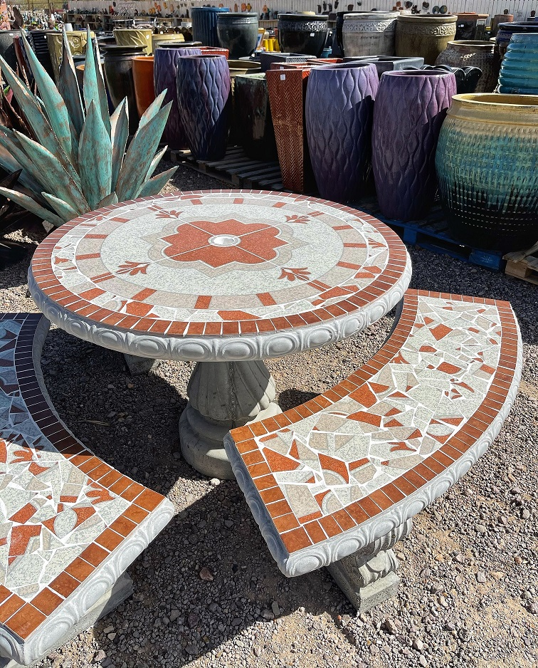 white and brown round garden tile table with benches